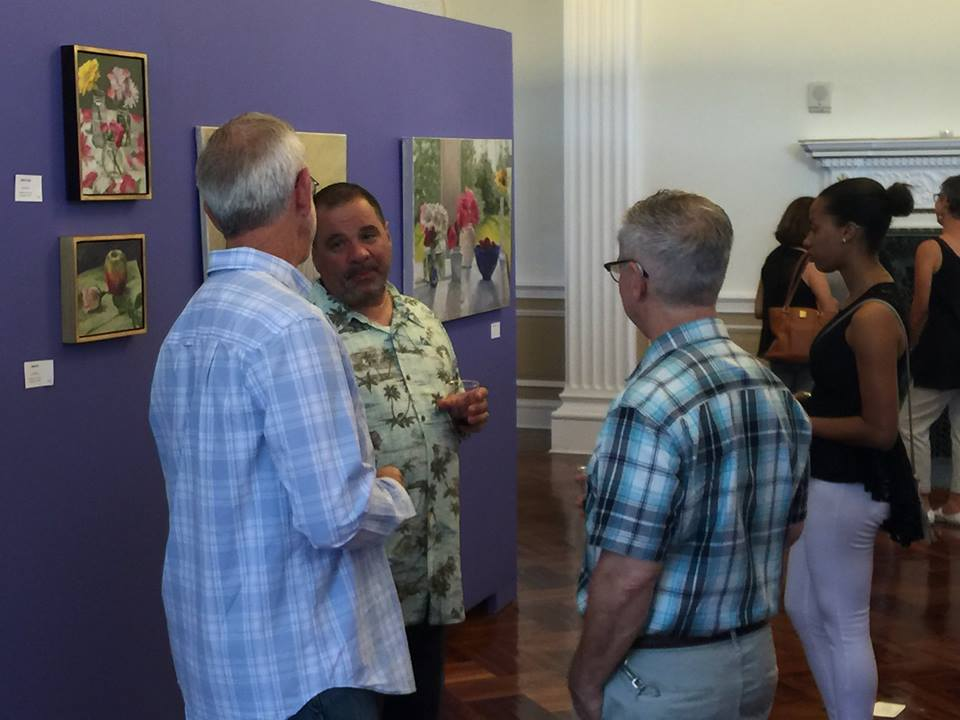 Anthony Casasanto (right) in rapt conversation with visitors.